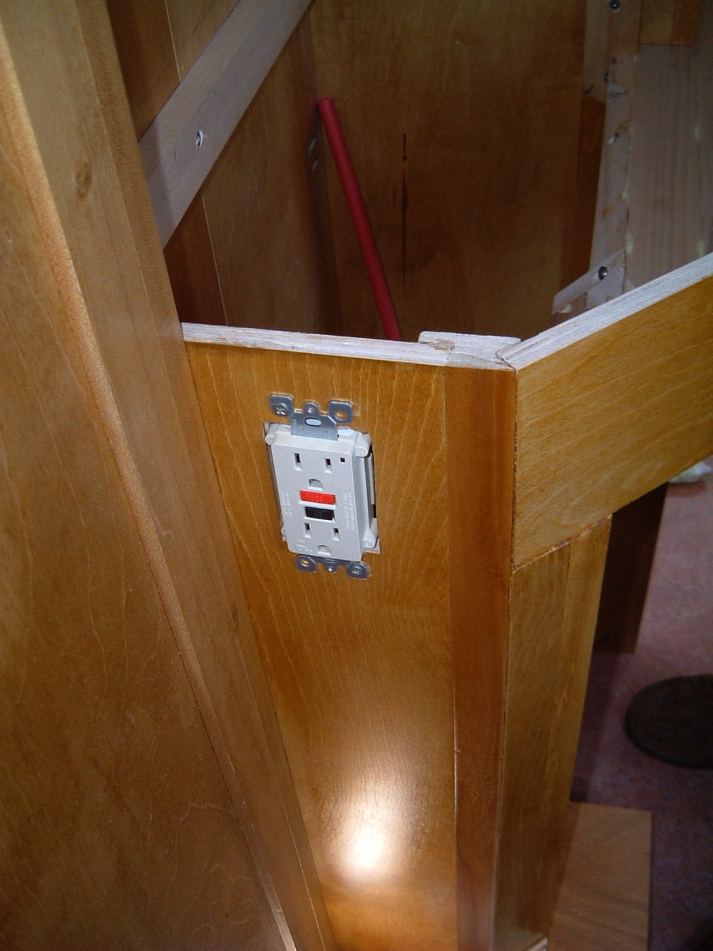 inside view of the breaker panel under bathroom sink cabinet and the gfi outlet protecting all the downstream outlets too cabinet outlets switches